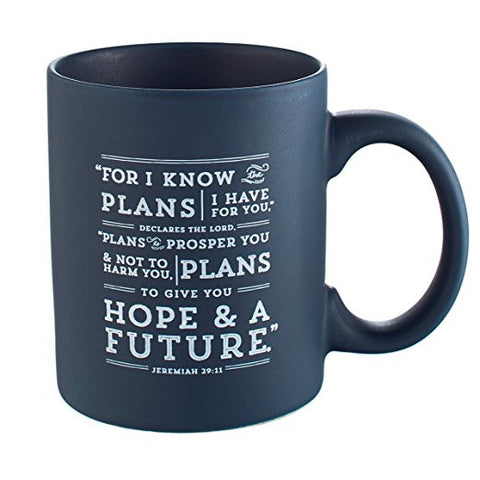 Navy blue ceramic mug has Scripture from Jeremiah 29:11 on one side that reads 'For I Know The Plans I Have For You, Declares The Lord. Plans To Prosper You & Not To Harm You, Plans To Give You Hope & A Future.'