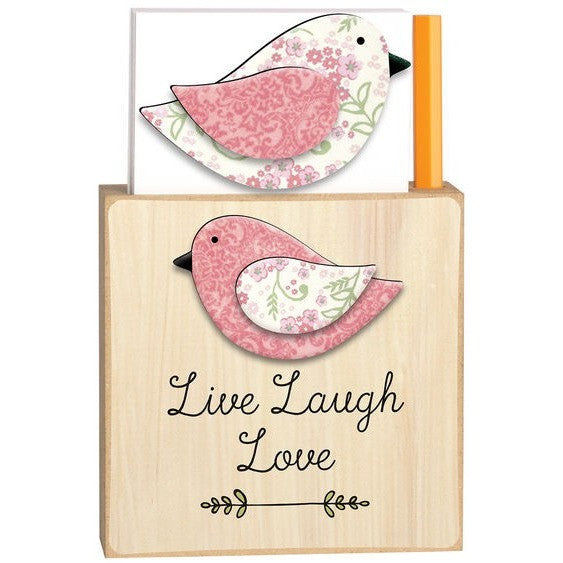Magnetic note holder base is made from natural colored wood and has the design of a pink, white and green floral bird. Message is in black script. Coordinating bird magnet has a white, pink and green floral design.