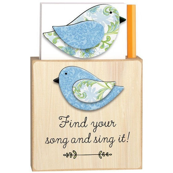 Magnetic note holder base is made from natural colored wood and has the design of a blue, white and green floral bird. Message is in black script. Coordinating bird magnet has a white, blue and green floral design.