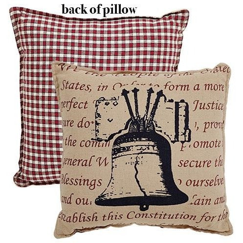 Made of natural fabric with a red gingham backing, the Independence Bell Pillow features a screen-printed Liberty Bell with red words in the background.