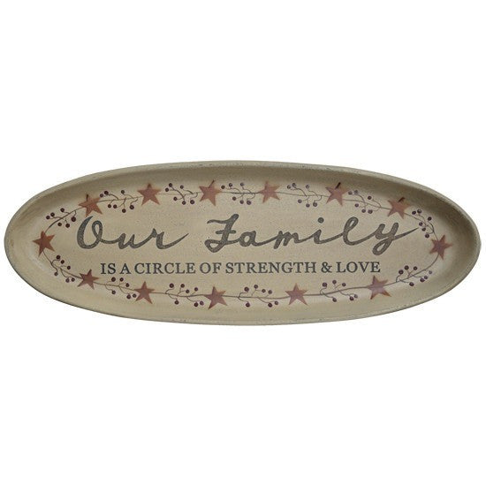 Oval wood tray has a distressed ivory beige finish, painted berry vine trim, and rusty orange star decorations. Message is in a combination of cursive and stenciled lettering.