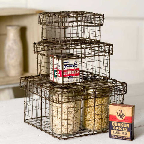 These boxes have a rusted wire finish for an antiqued look and each has a convenient lid so you can store and stack.  Nesting wire boxes come in three sizes.