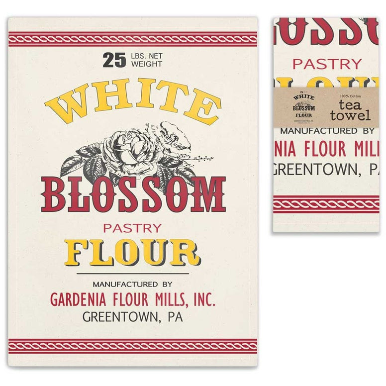 Vintage style tea towels feature the design of an old fashioned flour sack that features a 'White Blossom Flour Label'. Towels include a corner hanging tab.
