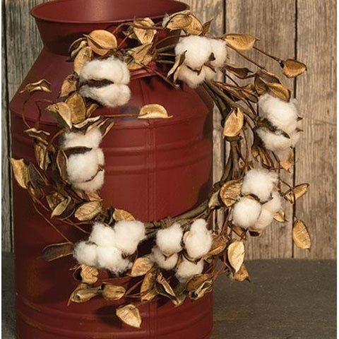 Wreath features real cotton buds in their natural shells alongside dried cotton pods on a brown wrapped, floral wreath.