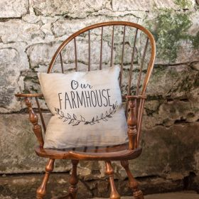 This rustic style white pillow features a country message of 'Our Farmhouse' in script across the front and includes a unique vine design.