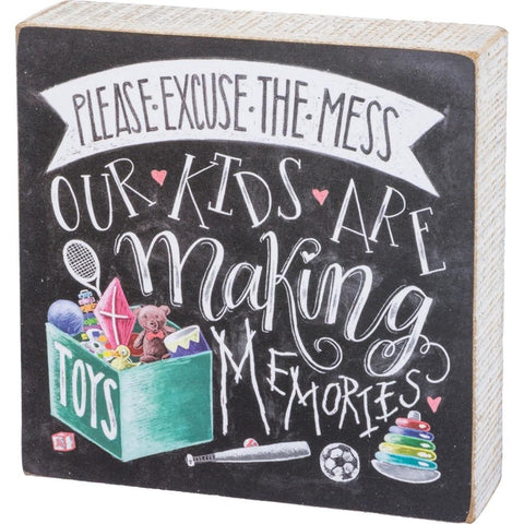 Wood box sign features a colorful design and the message 'Please Excuse The Mess Our Kids Are Making Memories' in fun font.