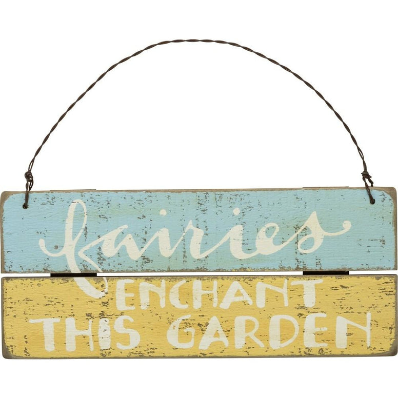 Plaque is made of wood and has a blue and yellow distressed finish. The white lettering gives this sign a vintage look and features the message 'Fairies Enchant This Garden'.