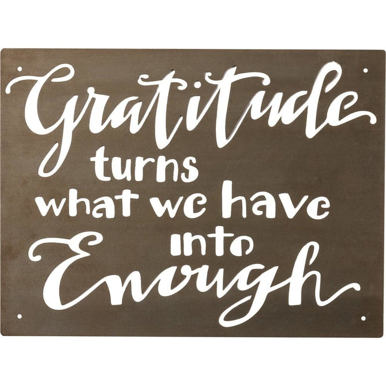 Cut out of a metal plate, the message of 'Gratitude Turns What We Have Into Enough' is written in fun script and the piece comes ready to hang with four predrilled holes.