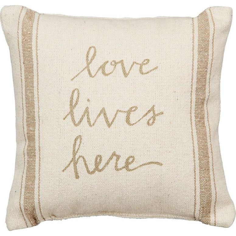 Beautiful tan stripes on a rustic cream background add a special touch to this decorative pillow that features the message 'Love Lives Here' is lovely script.