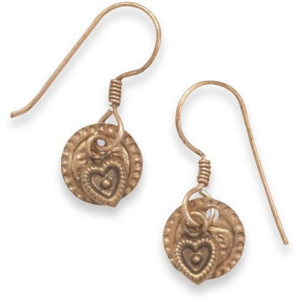 Earrings have a delicate copper coin charm and a small open heart charm hanging on a french wire.
