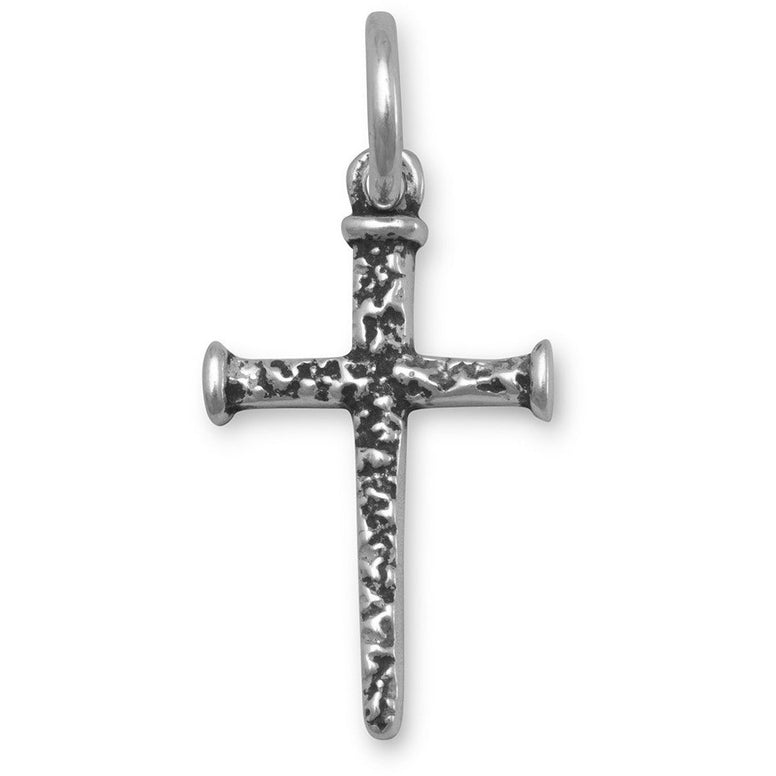 Oxidized sterling silver pendant depicting rustic style nails in the form of a cross.