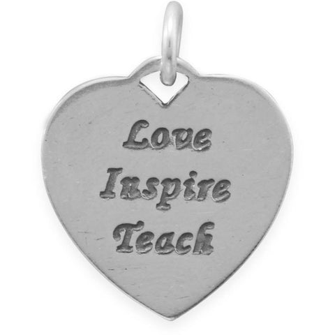 Heart shaped sterling silver charm inscribed with message 'Love Inspire Teach'.