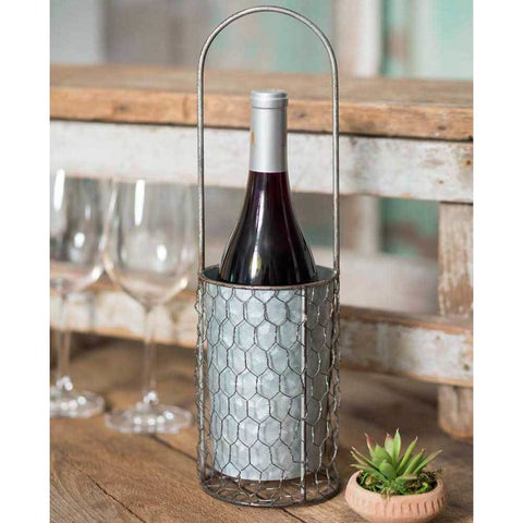 This wine carrier is made from galvanized metal and has a fixed handle for easy carrying.