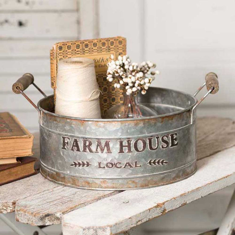 This round bin features a distressed galvanized finish and a special 'Farm House Local' design.