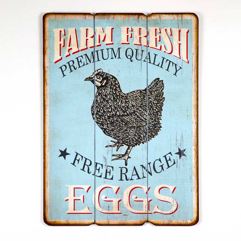 Wood sign features a distressed light blue, red and white design.  Sign has a wood plank look and vintage style black chicken design. It also reads 'Farm Fresh Eggs - Premium Quality - Free Range'.