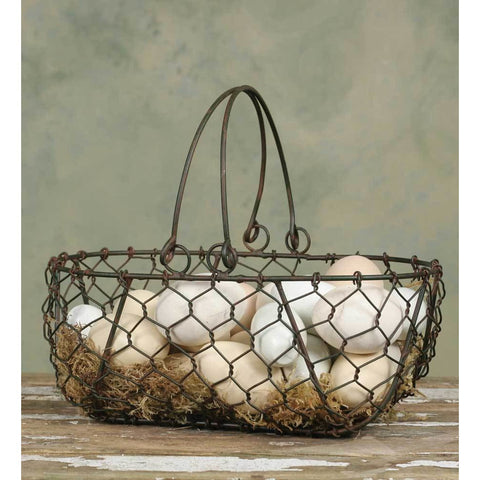 This metal vintage farmhouse style gathering basket features a distressed dark finish and chicken wire design.