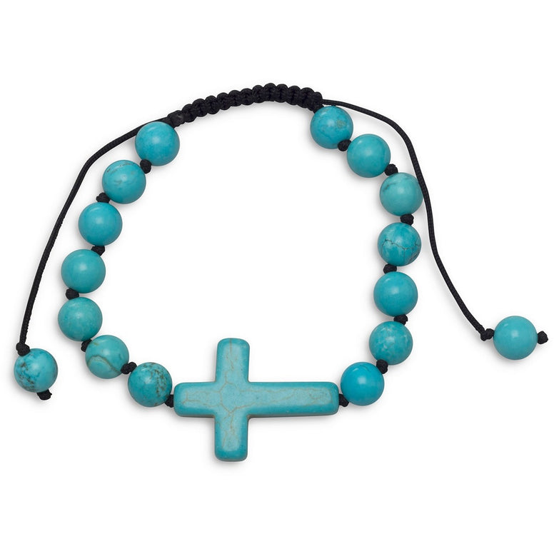 Adjustable bracelet is made with black cord, blue magnesite beads and large sideways cross
