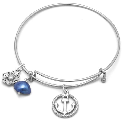 A flower charm, blue dyed freshwater pearl charm and flower charm highlight this expandable style silver tone fashion bangle bracelet.
