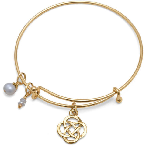 Expandable gold tone bracelet comes with a Celtic charm, a cultured freshwater pearl charm and a double cultured freshwater seed pearl drop.
