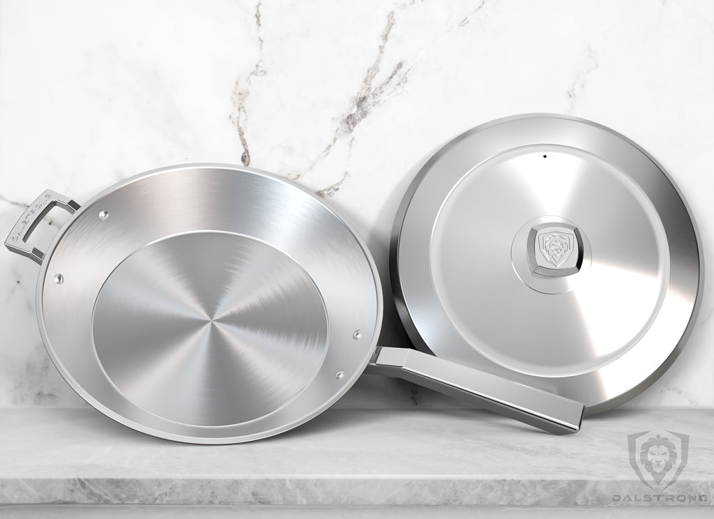 Dalstrong Avalon Series Skillet Frying Pan and Lid Resting Against A White Kitchen Tiled Wall On A Grey Granite Counter