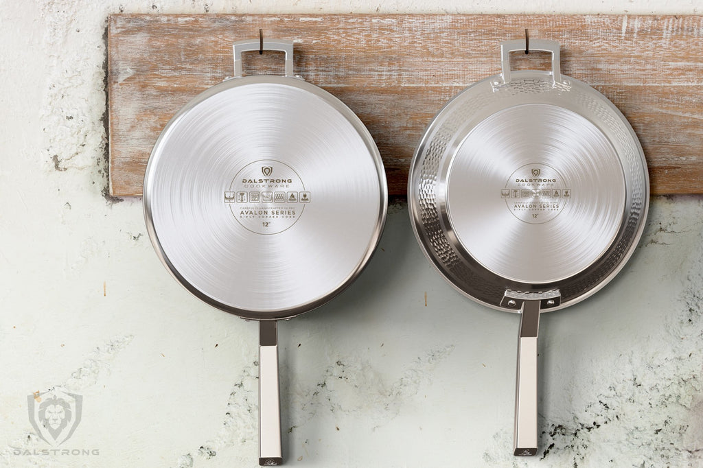 A stainless steel pot and frying pan dangle from hooks on a wooden kitchen rack