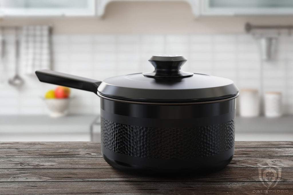 Avalon Series Black 3 Qt Stock Pot On Brown Wooden Kitchen Counter