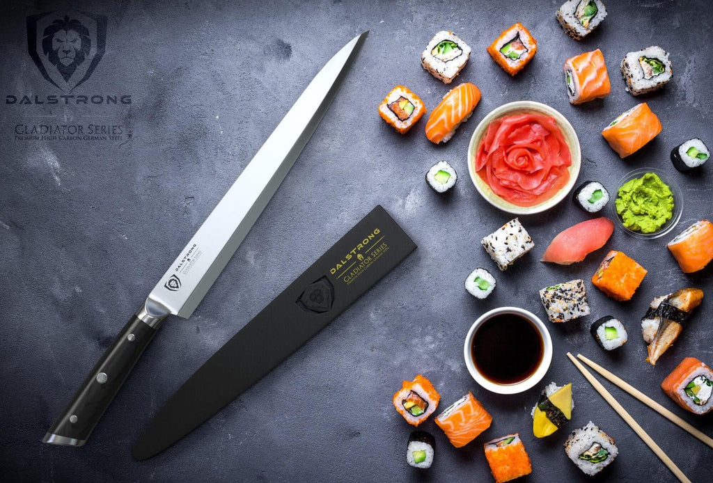 Yanagiba slicer next to a bowl of soy sauce and a wide range of sushi pieces