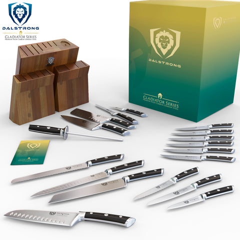 18 Piece knife set displayed on a white surface in front of their wooden block and Dalstrong packaging