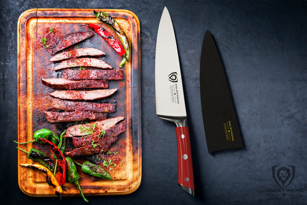 Cutting board with cooked slices of meat next to a sharp chef knife with a red handle