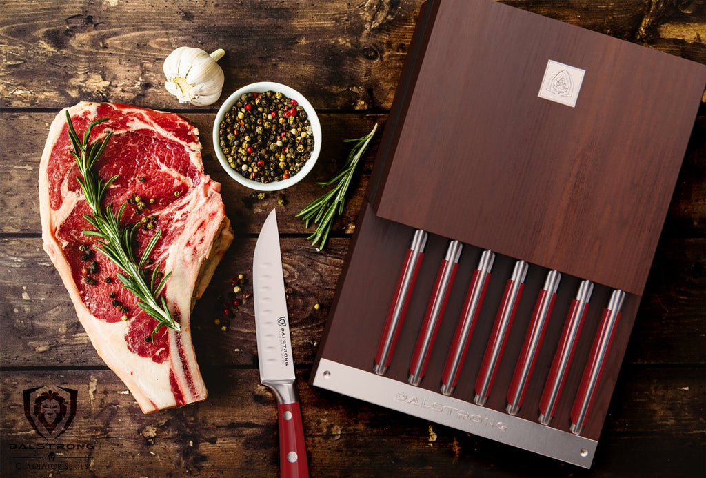 Uncooked steak with garnish next to eight piece steak knife set with one knife outside of the block