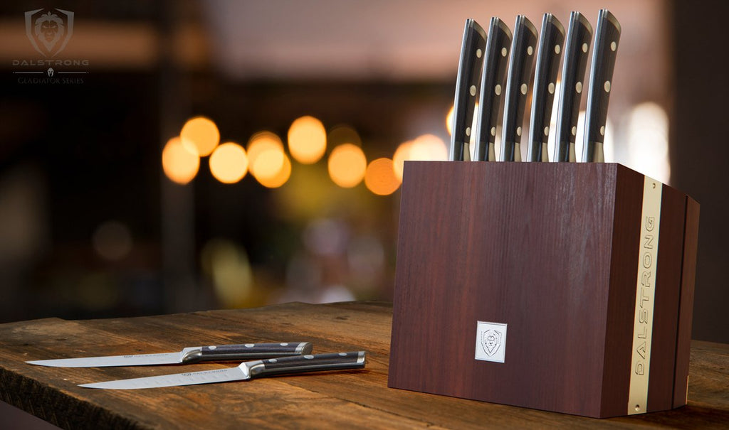 8 Piece steak set in a knife block on a wooden counter and dark background