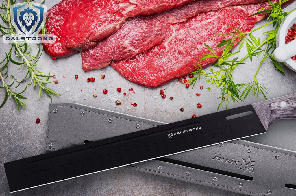 A black carving knife in front of three pieces of uncooked steak