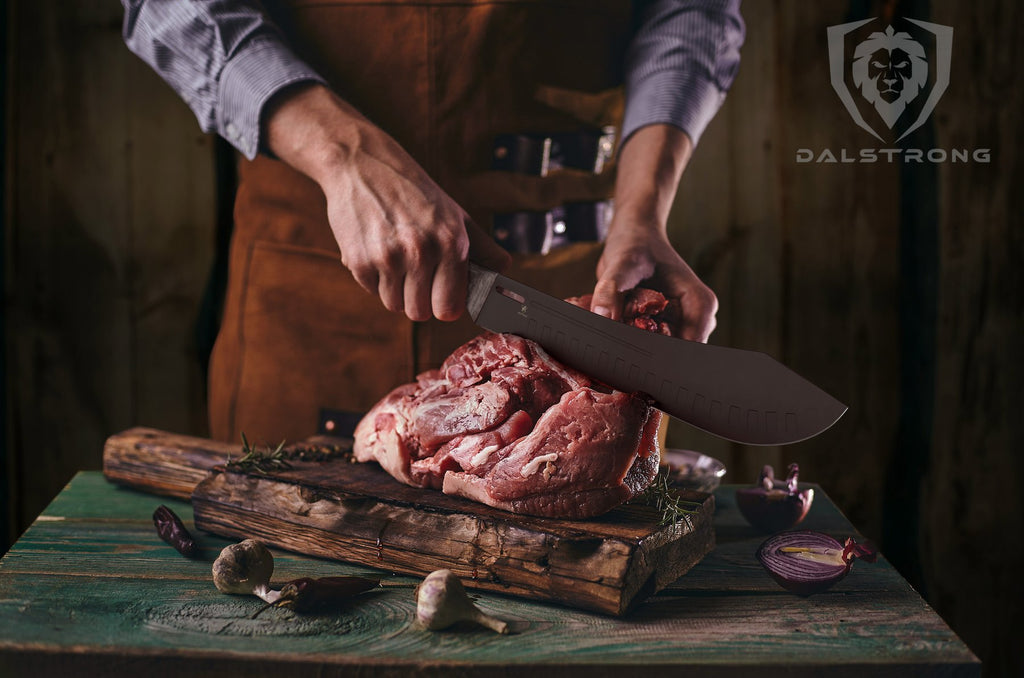 Man uses black bull nose butcher knife to slice raw meat on a wooden cutting board