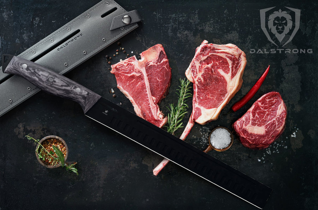 cut steaks with Dalstrong carving knife and sheath beside it