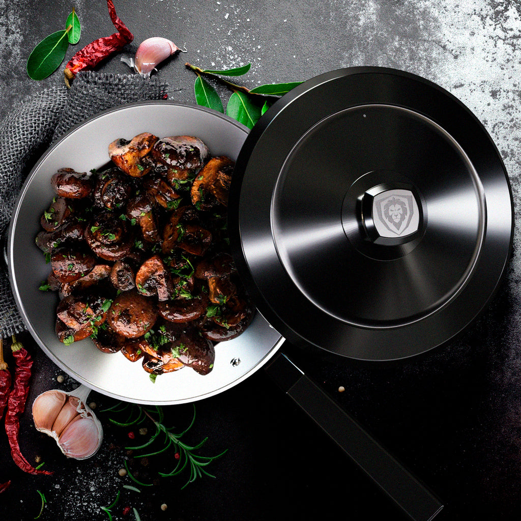 Saute mushrooms in a skillet with a black lid balancing on the side