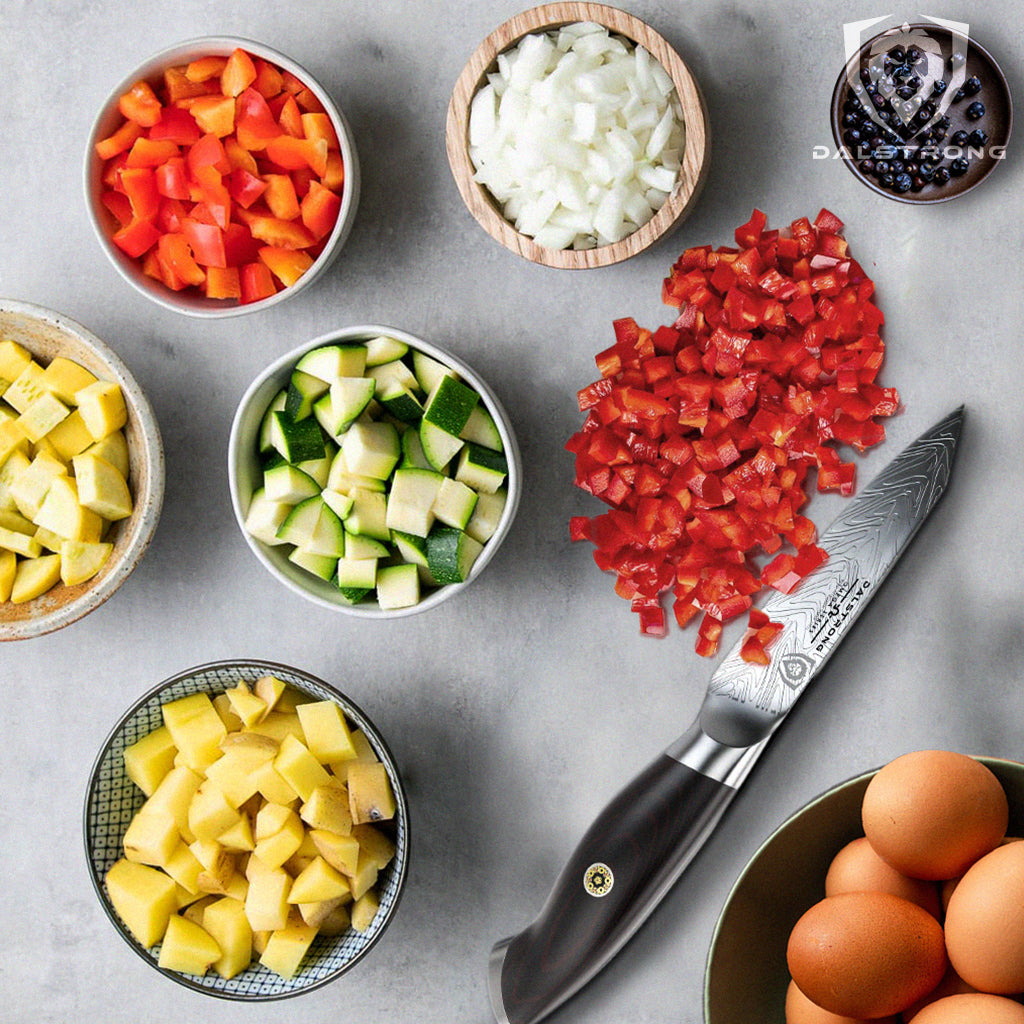 Small containers of frittata ingredients next to a sharp paring knife