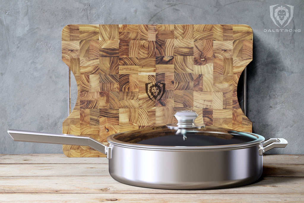 "Stainless Steel 12"" ETERNA Non-Stick Sauté Frypan on a wooden table with a cutting board in the background"