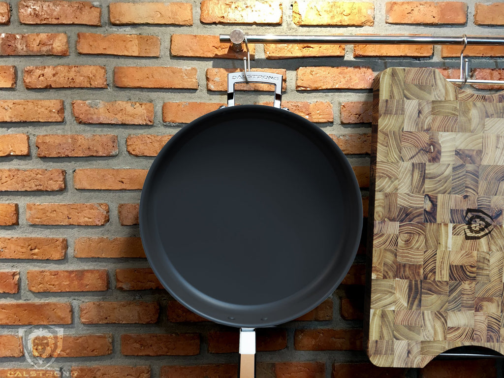 "12"" ETERNA Non-Stick Sauté Frypan - The Oberon Series hanging from a kitchen rod"