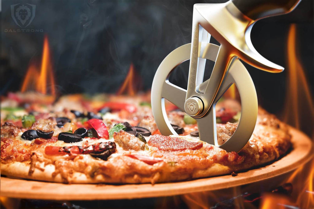 A pizza cutter slicing through a hot pizza with flames in the background