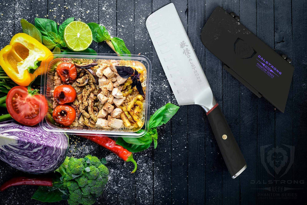 Colorful vegetables on a dark wooden surface next to a nakiri knife