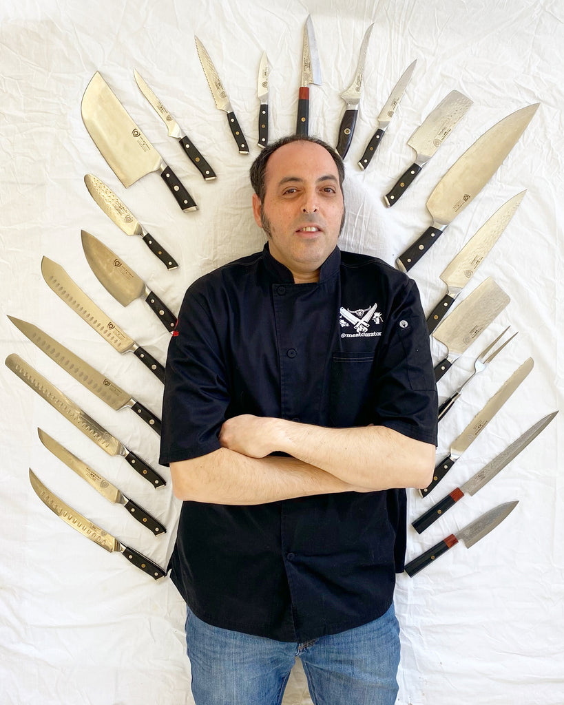 Chef Ruben Maislos @meatcurator poses with twenty two Dalstrong Chef knives surrounded him