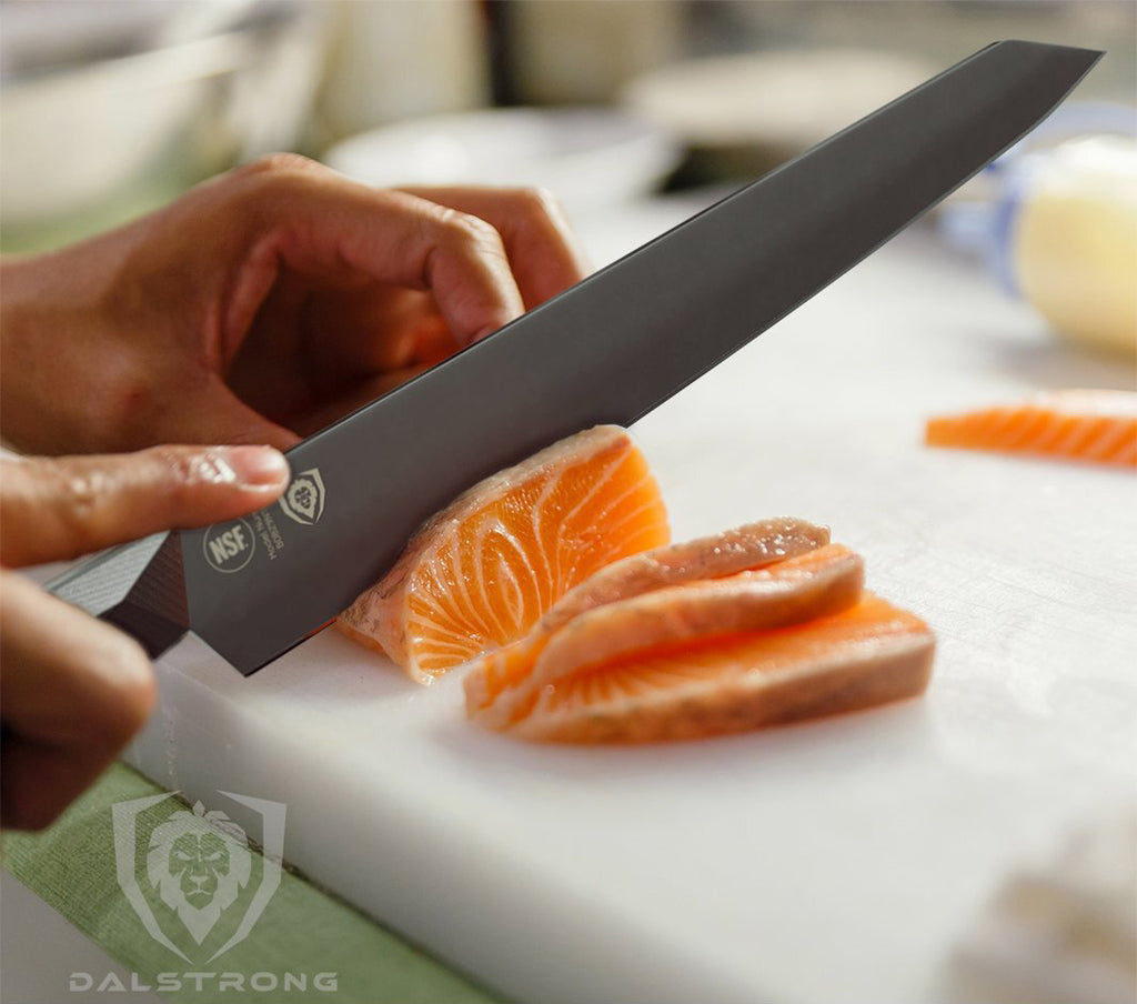 A Dalstrong Yanagiba Sushi Knife cutting into a piece of raw fish