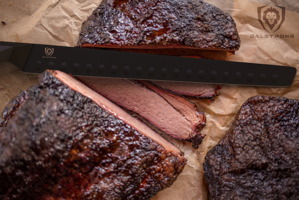 Smoked brisket with burnt ends sliced on a cutting board with a black carving knife