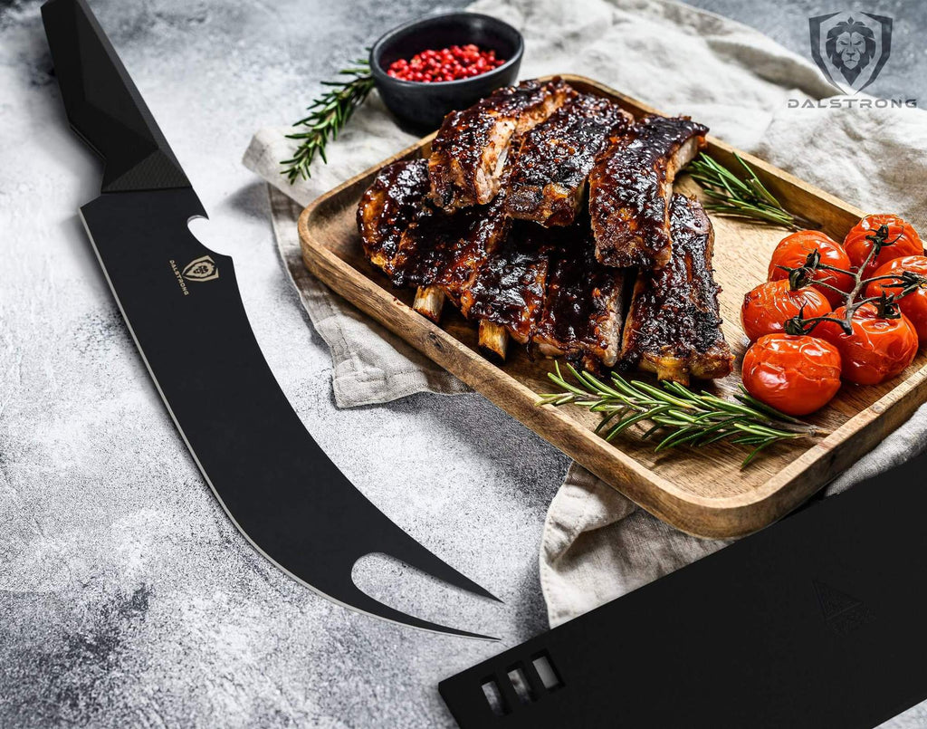 Fork tipped butcher knife on white surface next to a tray of bbq ribs