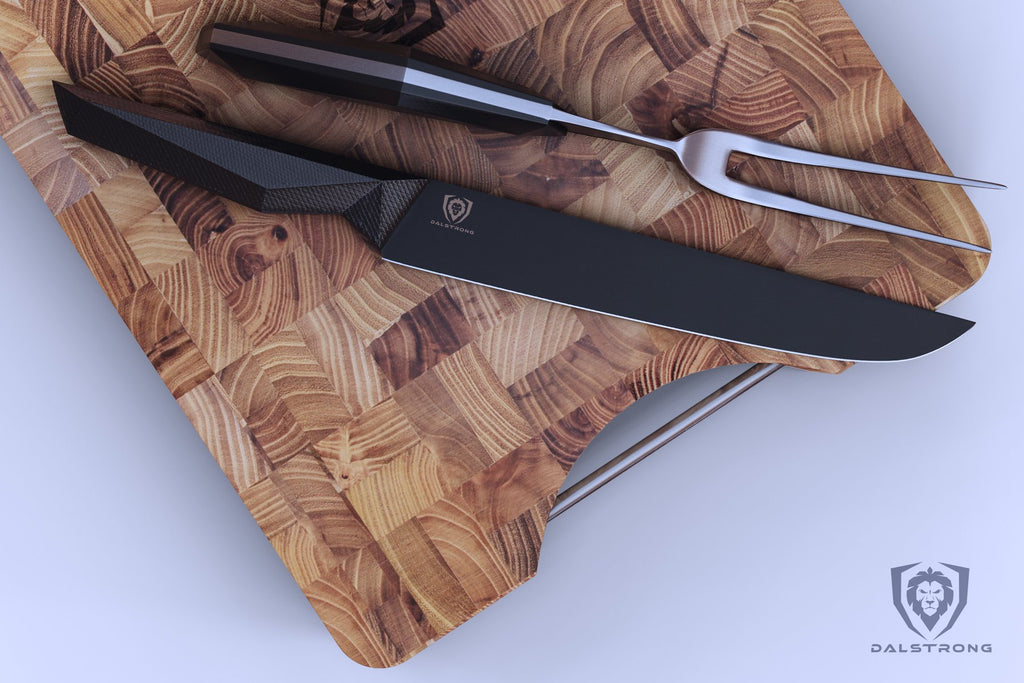 Black carving knife and steel fork on a wooden cutting board with a white background