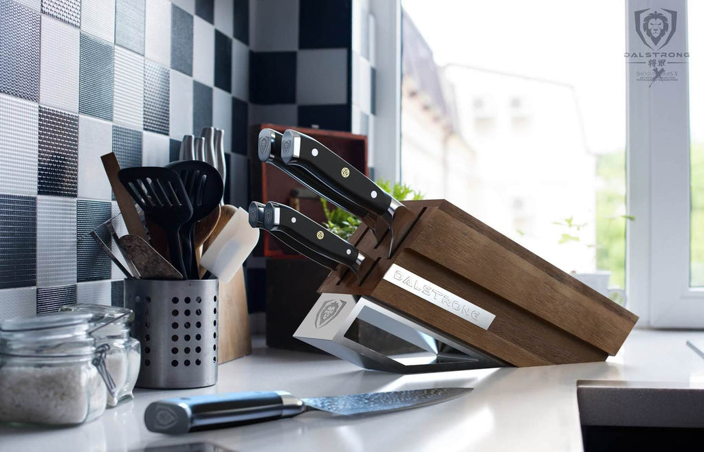 Wooden knife block with five knives on a kitchen counter