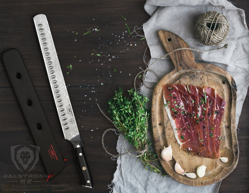 large carving knife next to a cutting board with thinly sliced ham