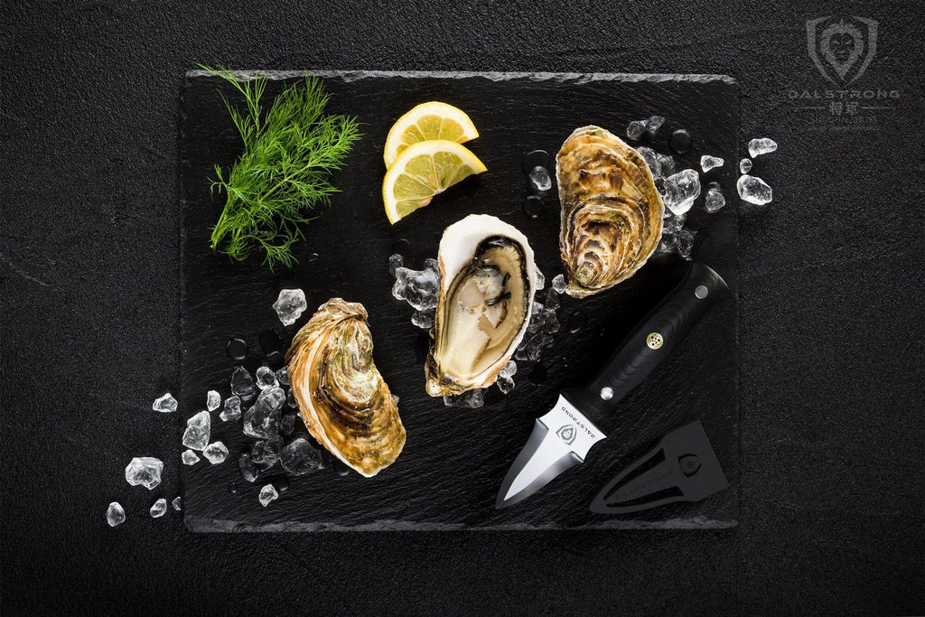 A dark plate of oysters and garnish beside a premium oyster knife