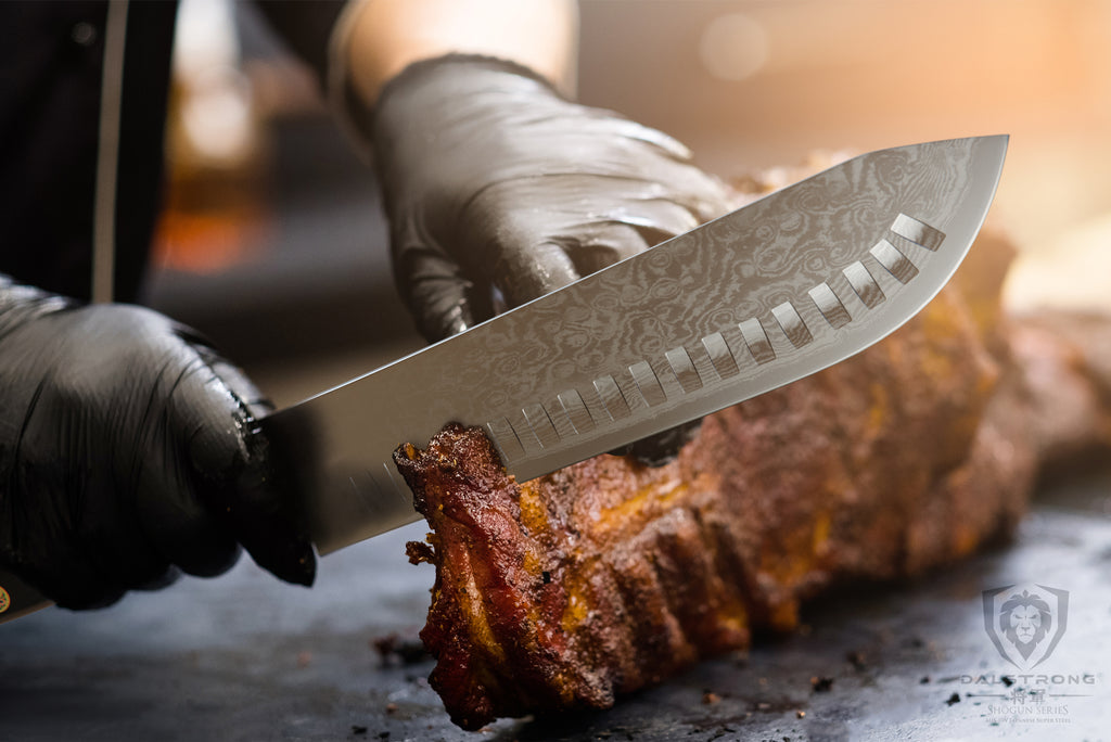 A man using black gloves slices through a rack of meat with a silver butcher knife