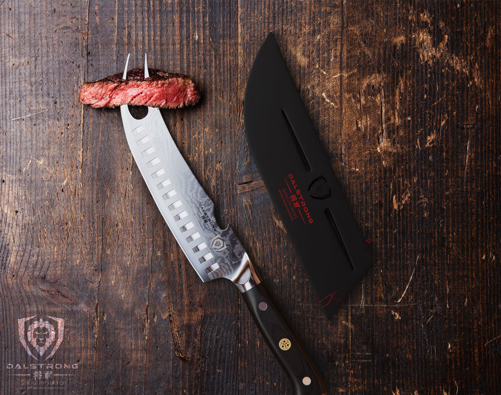 Two pronged butcher knife with steak at the tip resting on a dark wooden table